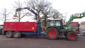 Foremost Treesurgeons - Tractor and trailor Grab Loader